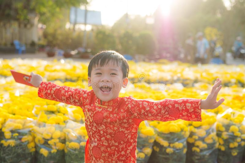 Portrait of a Asian boy on traditional festival costume. Cute little Vietnamese boy in ao dai dress smiling. Tet holiday. Lunar. New Year Vietnam royalty free stock photo