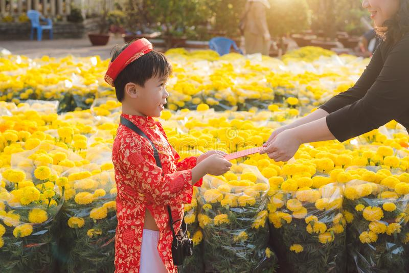 Portrait of a Asian boy on traditional festival costume. Cute little Vietnamese boy in ao dai dress smiling. Tet holiday. Lunar Ne royalty free stock image