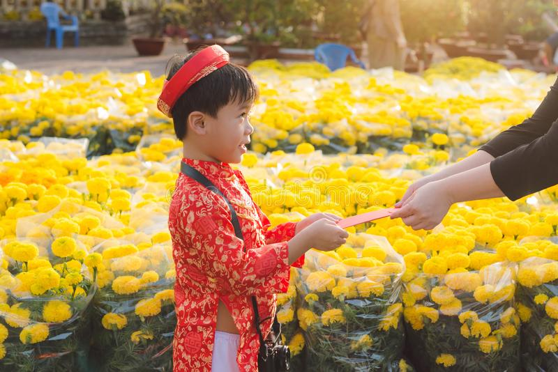 Portrait of a Asian boy on traditional festival costume. Cute little Vietnamese boy in ao dai dress smiling. Tet holiday. Lunar Ne. W Year Vietnam royalty free stock photo
