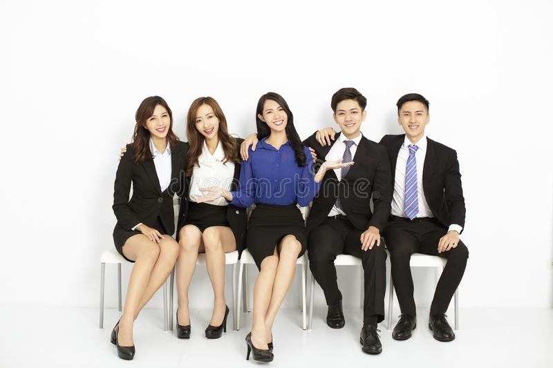 Portrait of asian business people sitting on the chairs royalty free stock photo