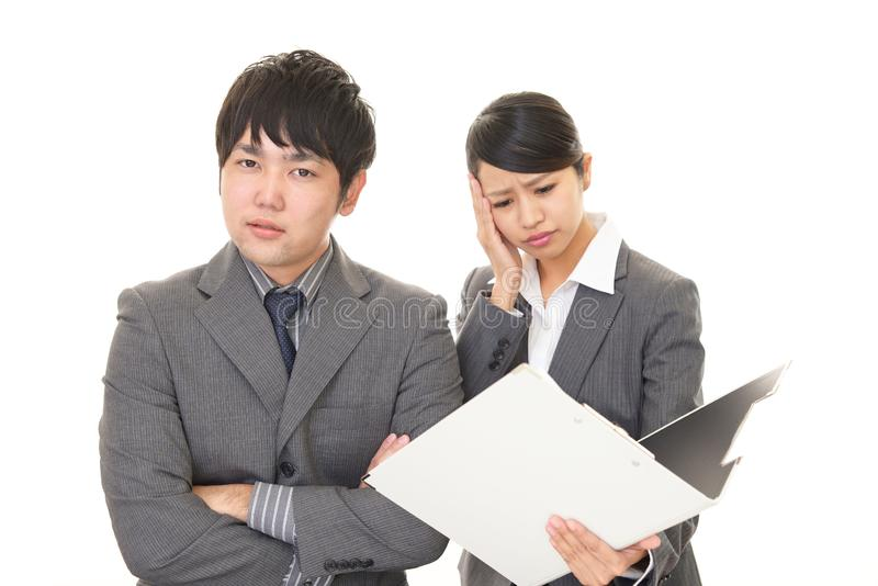 Dissatisfied businessman and businesswoman. Portrait of Asian business people in their office stock images