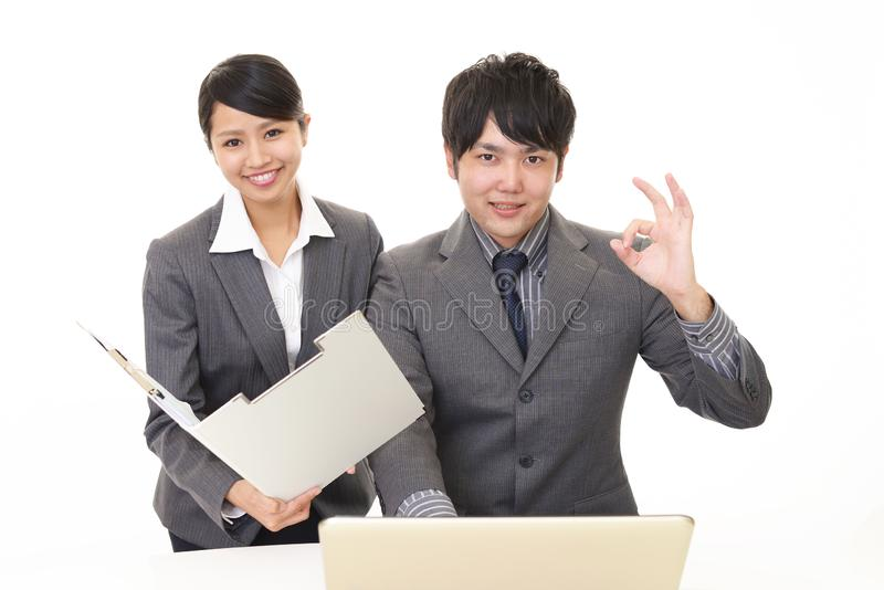 Smiling businessman and businesswoman. Portrait of Asian business people in their office stock photos