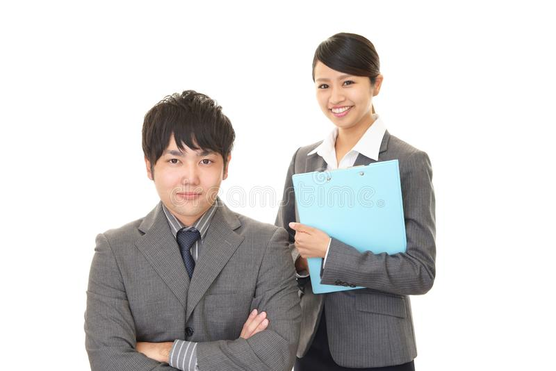 Smiling businessman and businesswoman. Portrait of Asian business people in their office stock image