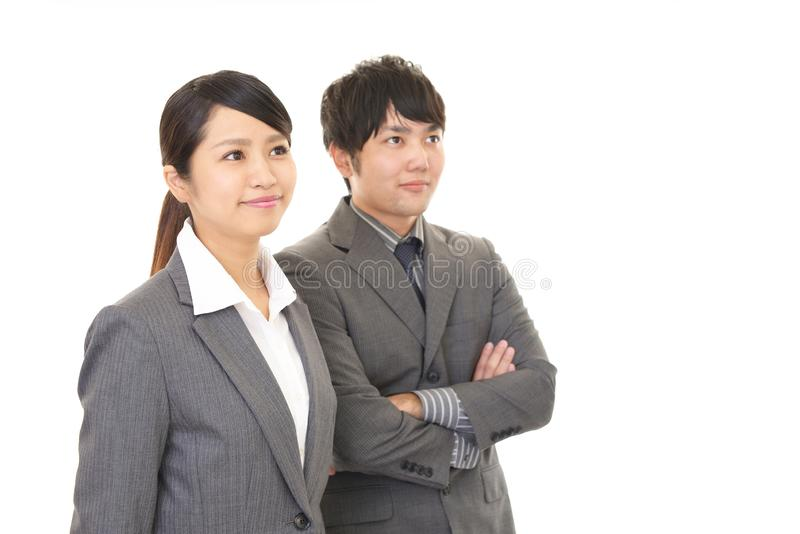 Smiling businessman and businesswoman. Portrait of Asian business people in their office royalty free stock photo