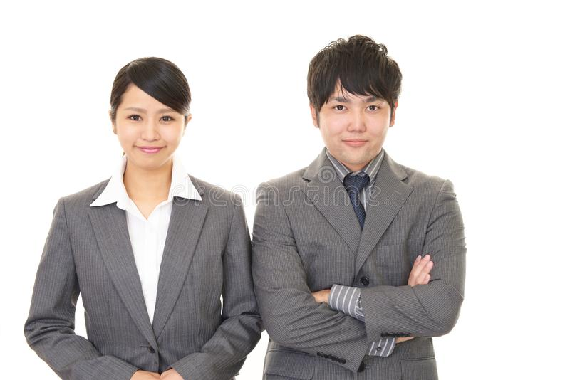 Smiling businessman and businesswoman. Portrait of Asian business people in their office royalty free stock photography