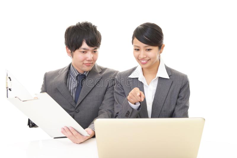 Smiling businessman and businesswoman. Portrait of Asian business people in their office stock photo