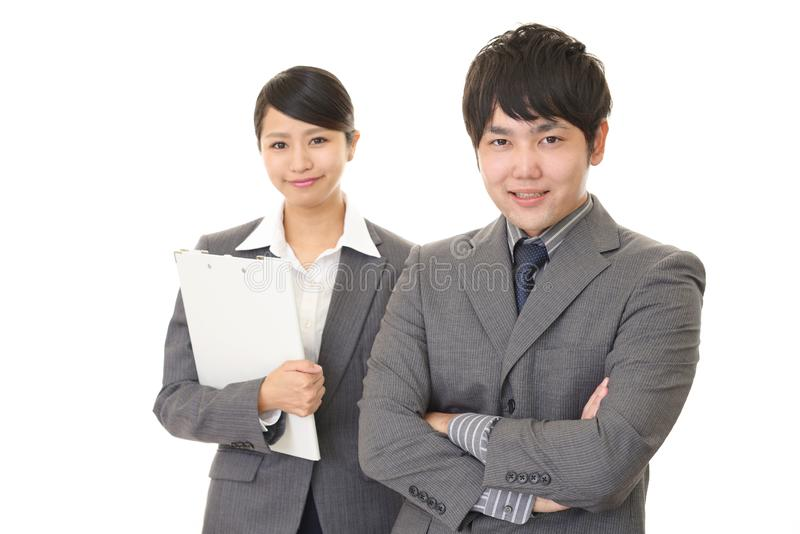 Smiling businessman and businesswoman. Portrait of Asian business people in their office stock images