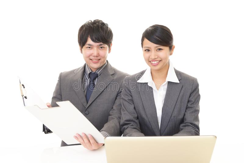 Smiling businessman and businesswoman. Portrait of Asian business people in their office royalty free stock images