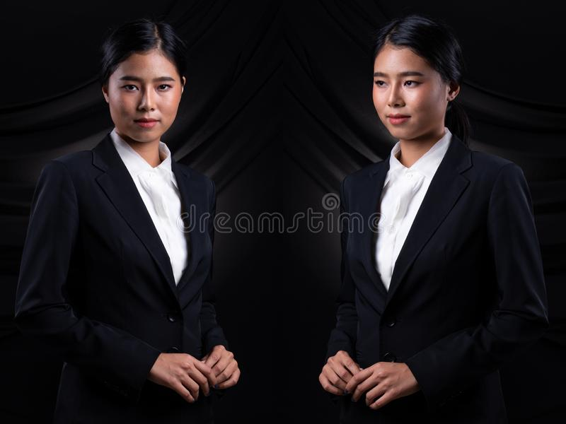 Asian Business Woman Stand in dark Formal Suit. Portrait Asian Business Woman dark blue Formal proper Suit, studio lighting black drape fabric background, Lawyer royalty free stock photos