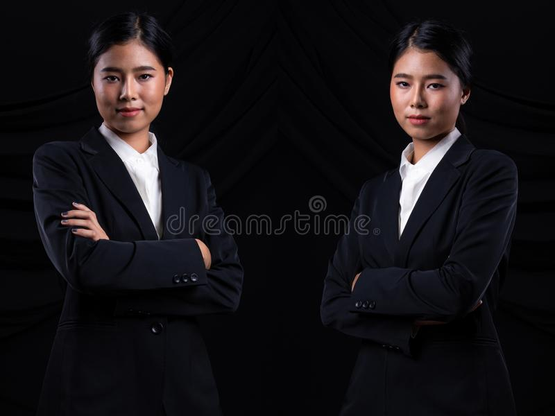 Asian Business Woman Stand in dark Formal Suit. Portrait Asian Business Woman dark blue Formal proper Suit, studio lighting black drape fabric background, Lawyer royalty free stock images