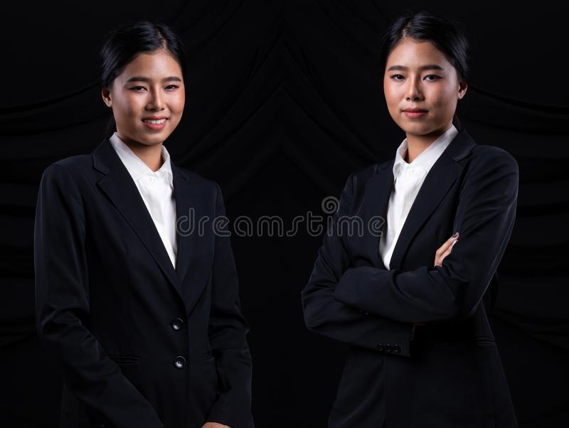 Asian Business Woman Stand in dark Formal Suit. Portrait Asian Business Woman dark blue Formal proper Suit, studio lighting black drape fabric background, Lawyer stock photos