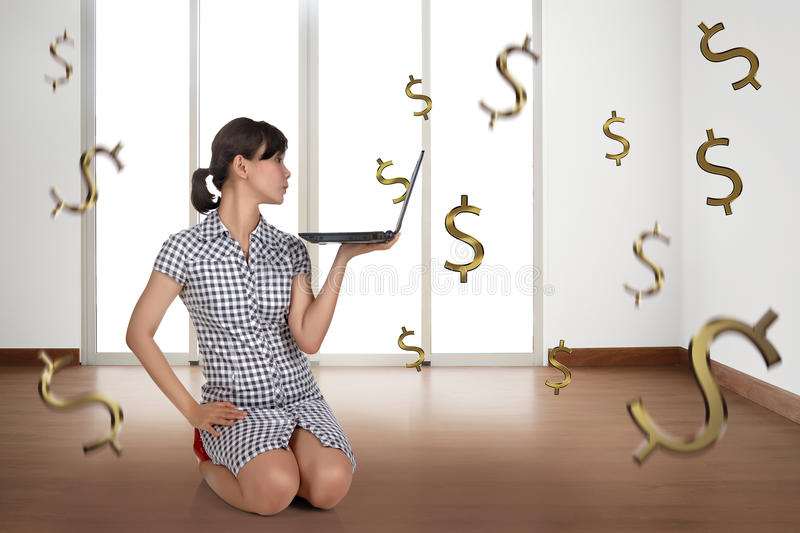 Portrait of asian business woman holding laptop with tax sign. In the office room stock images