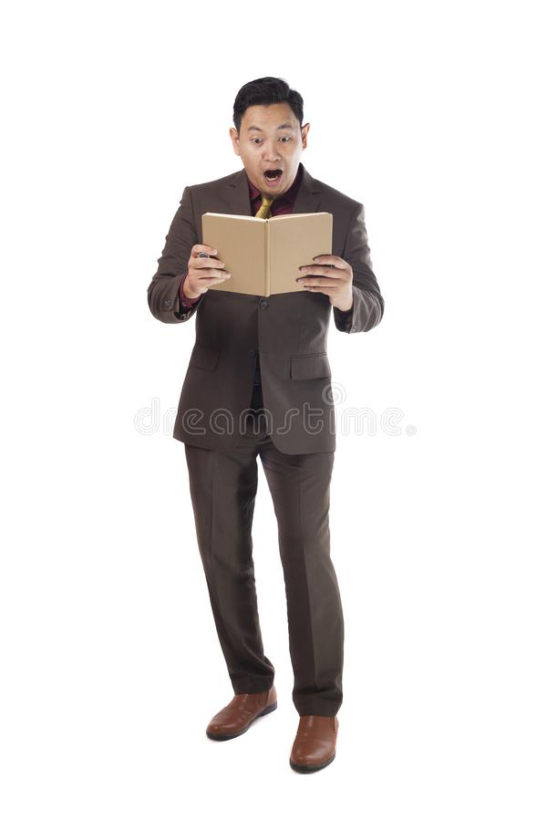 Asian Man Shocked Surprised When Reading a Book stock photo