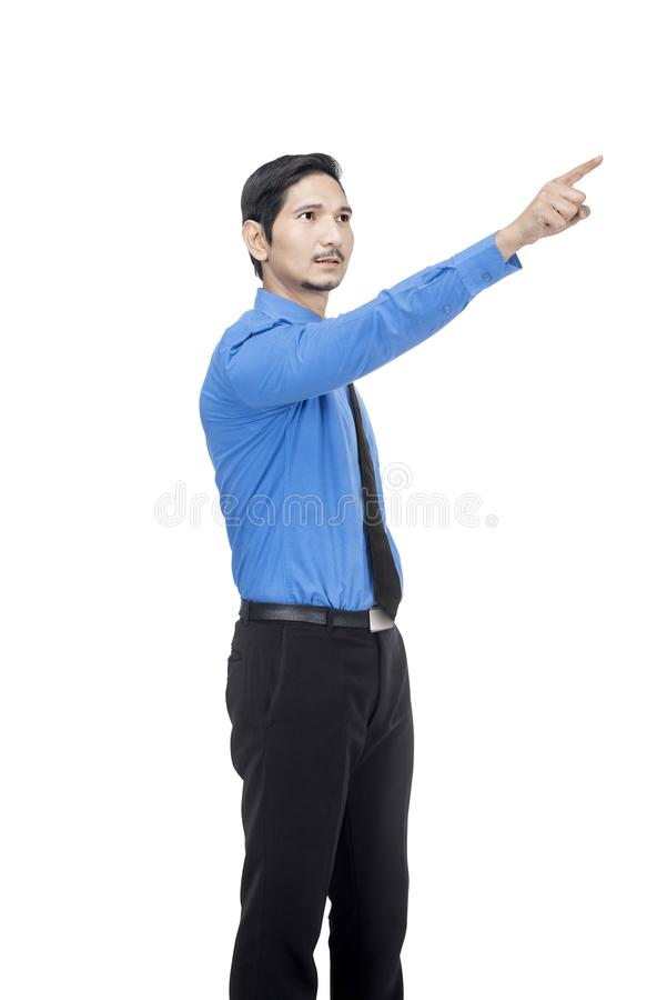 Portrait of asian businessman pointing something with his finger. Posing isolated over white background stock photos