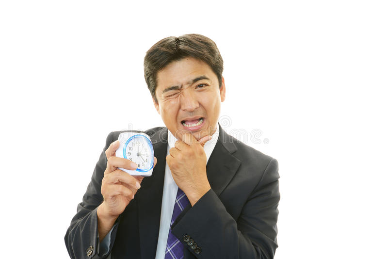 Portrait of Asian businessman who has no time royalty free stock photo