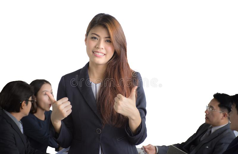 Portrait of Asian businesswoman standing in front of her team at office, female leader royalty free stock photo
