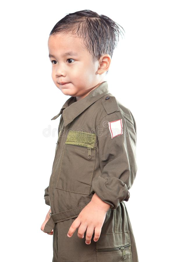 Portrait of asian children wearing military pilot suit isolated. White background royalty free stock image