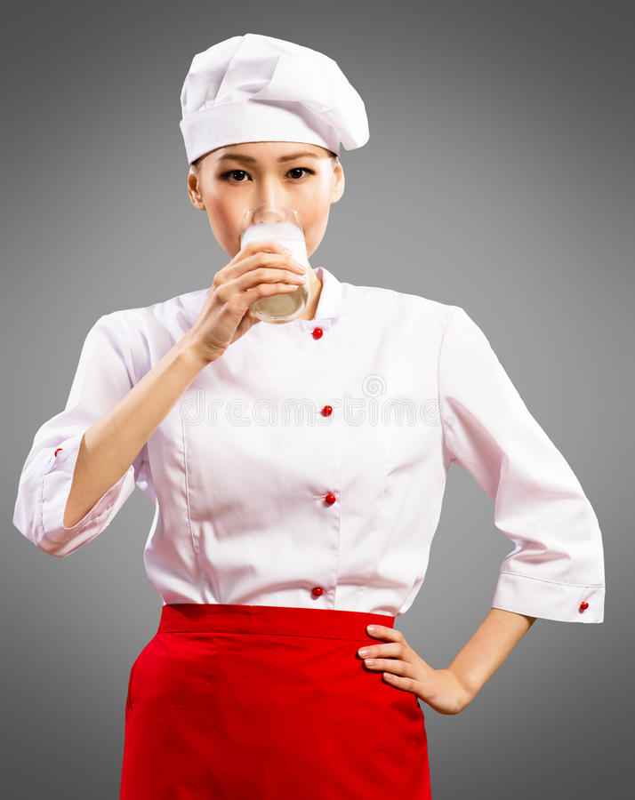 Asian cook drink milk royalty free stock images
