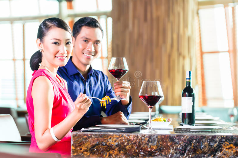 Portrait of Asian couple eating in restaurant royalty free stock photo
