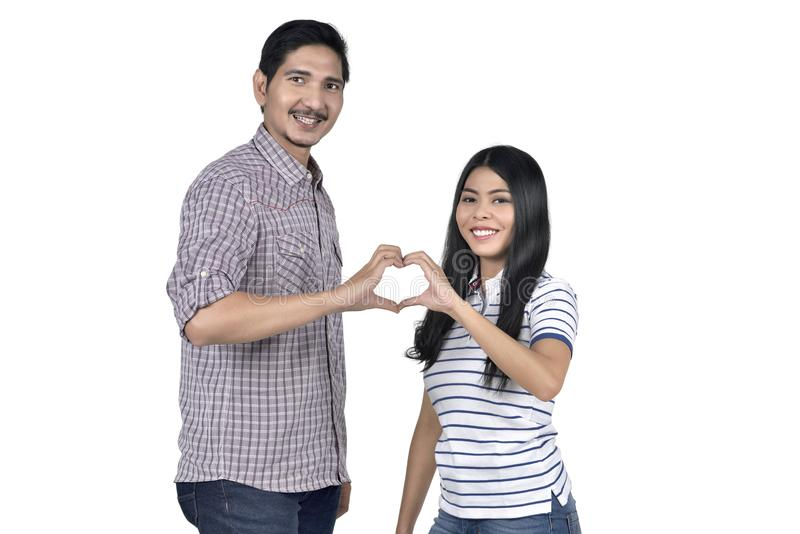 Portrait of asian couple in love making heart shape from their f royalty free stock images