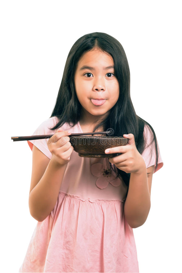 Portrait of Asian cute girl eating, using chopsticks ,isolated on white royalty free stock images