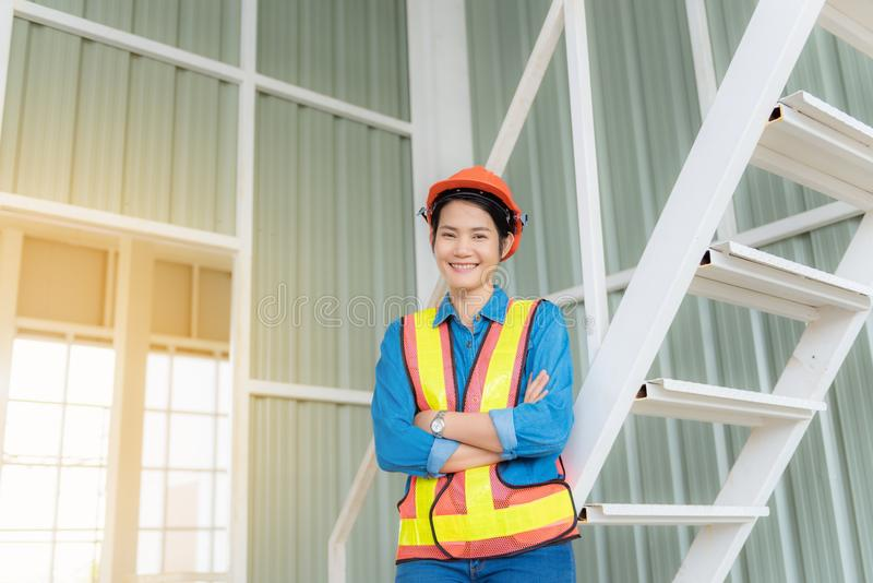 Portrait of asian engineer woman in construction site royalty free stock photo