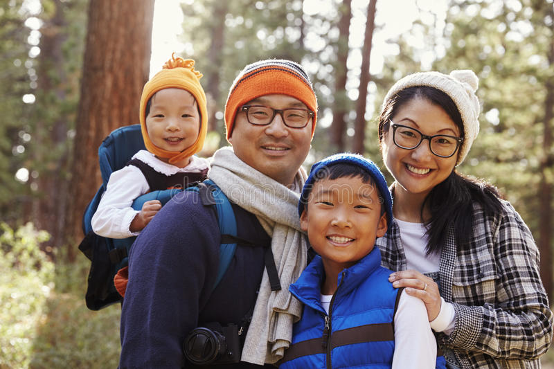 Portrait of an Asian family of four in a forest setting stock photography