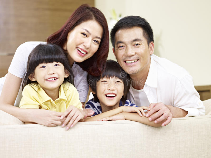 Portrait of an asian family with two children. Portrait of an asian family with two children, happy and smiling stock image