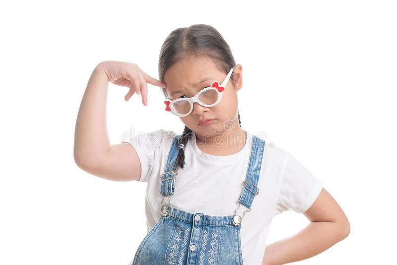 Portrait of Asian girl kid cute age 7 years on white background. Portrait of Asian girl kid cute age 7 years isolated on white background wearing Dungarees jean stock photography