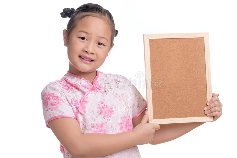 Portrait of Asian girl kid cute age 7 years on white background. Portrait of Asian girl kid cute age 7 years isolated on white background, wearing Pink Chinese royalty free stock photo
