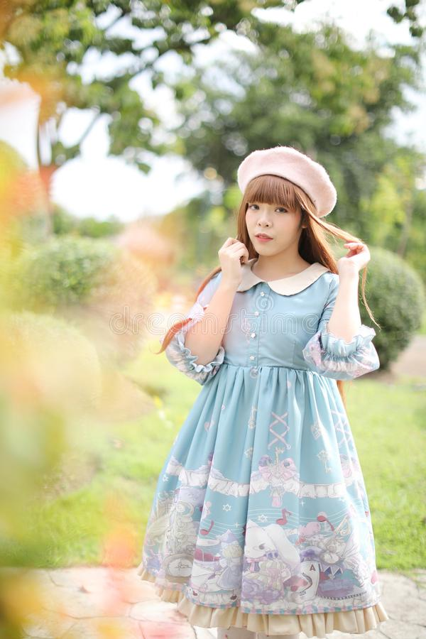 Portrait of asian girl in lolita fashion dress in garden royalty free stock photos
