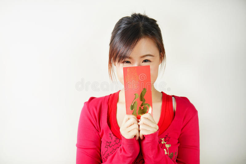 Portrait of Asian Girl with Red Envelopes in her hands. stock photo