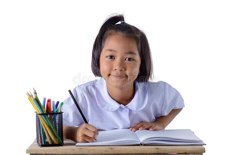 Portrait of asian girl in school uniform is drawing with color pencils isolated on white background stock image