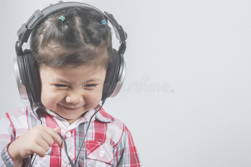 Portrait Asian Girl wear headphones with Long sleeve shirt with. Red pattern stock photography