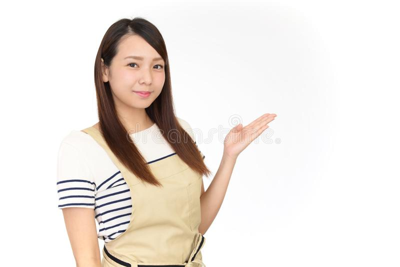 Smiling Asian housewife royalty free stock photography