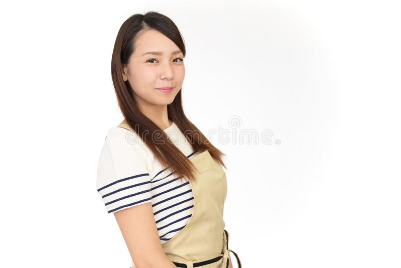 Smiling Asian housewife royalty free stock photos