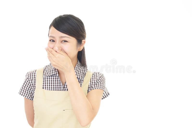 Woman covering her mouth. Portrait of an Asian housewife stock image