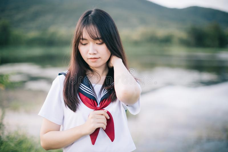 Portrait of asian japanese school girl costume looking at park outdoor film vintage style royalty free stock photos