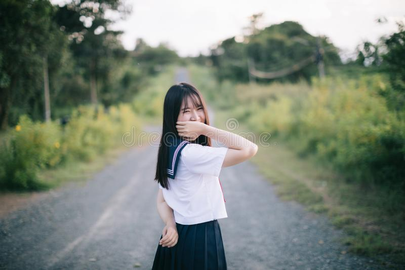 Portrait of asian japanese school girl costume looking at park outdoor film vintage style royalty free stock images