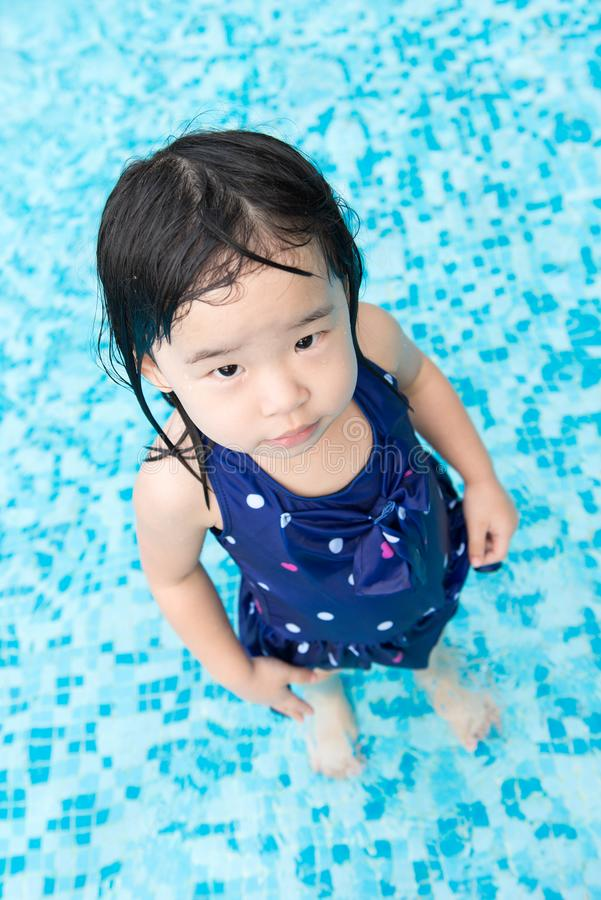 Asian little baby girl in swimming pool. Portrait of Asian little baby girl playing in swimming pool stock photos