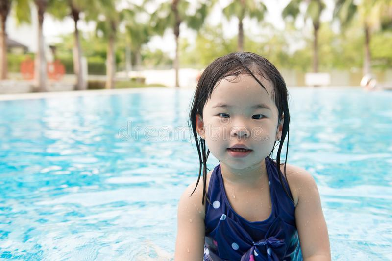 Asian little baby girl in swimming pool. Portrait of Asian little baby girl playing in swimming pool stock photography