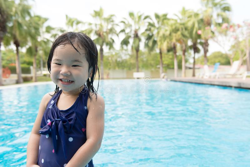 Asian little baby girl in swimming pool. Portrait of Asian little baby girl playing in swimming pool royalty free stock images