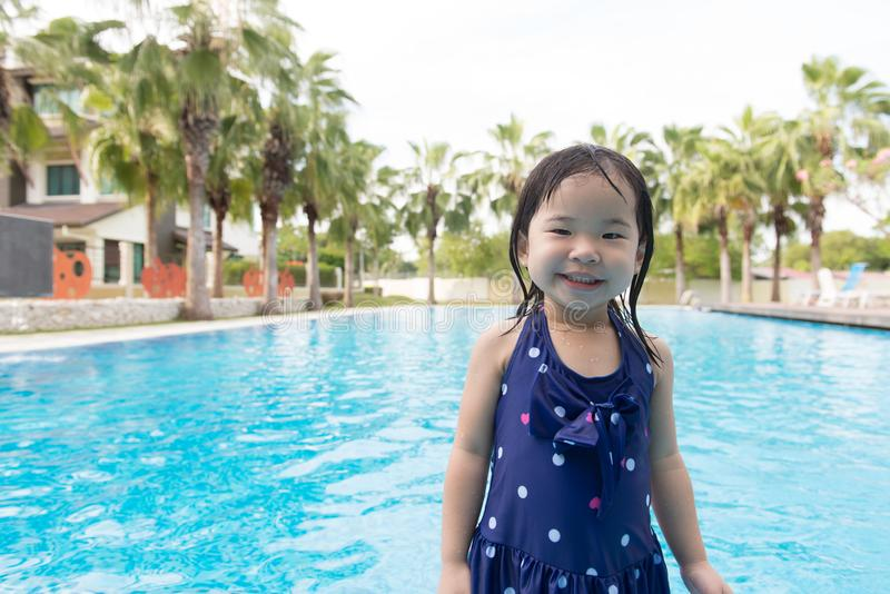 Asian little baby girl in swimming pool. Portrait of Asian little baby girl playing in swimming pool royalty free stock photos