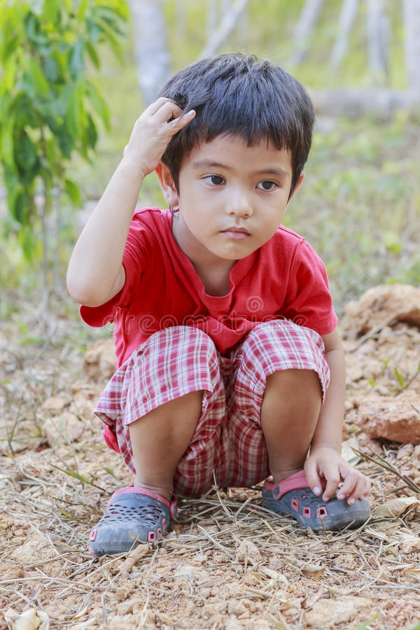 Portrait of Asian little boy. Outdoor royalty free stock image