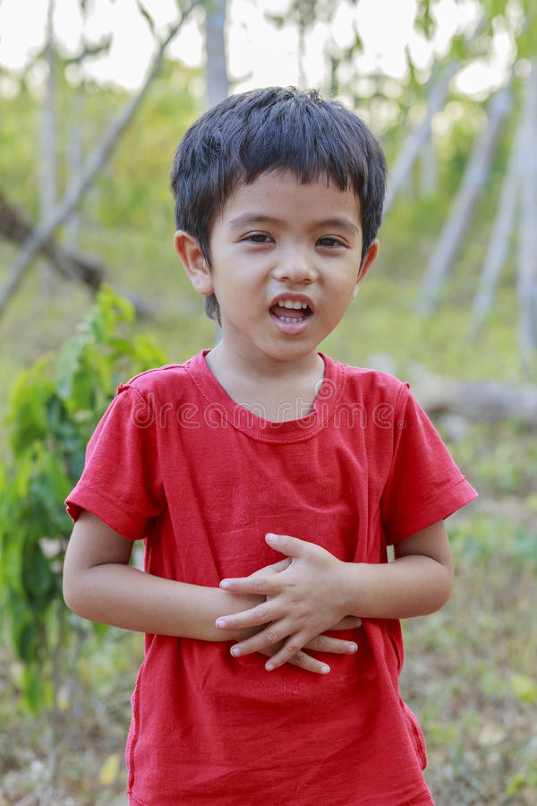 Portrait of Asian little boy. Outdoor royalty free stock photography