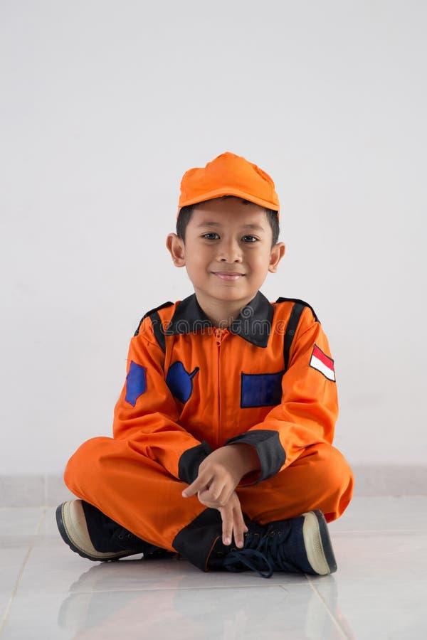 Asian little boy with technician, engineer or astronaut uniform stock photos
