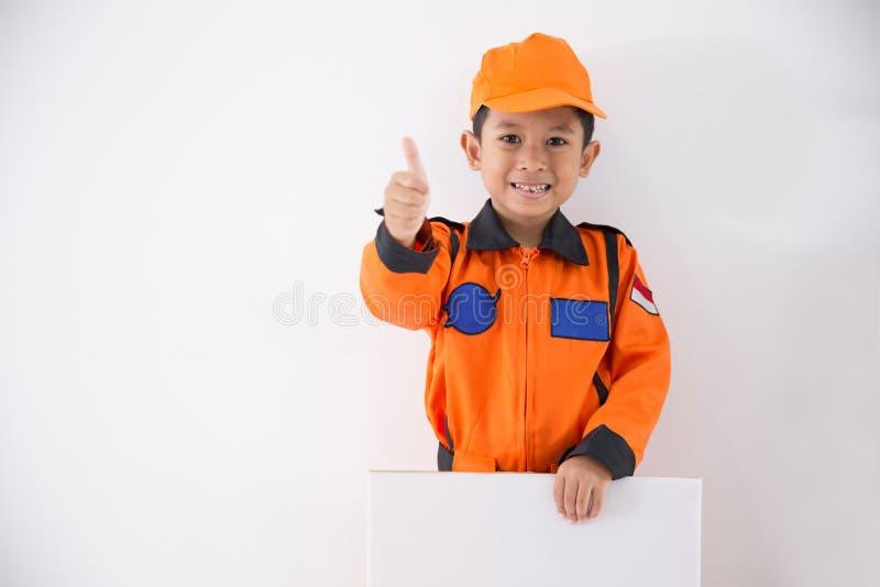 Asian little boy with technician, engineer or astronaut uniform stock photo
