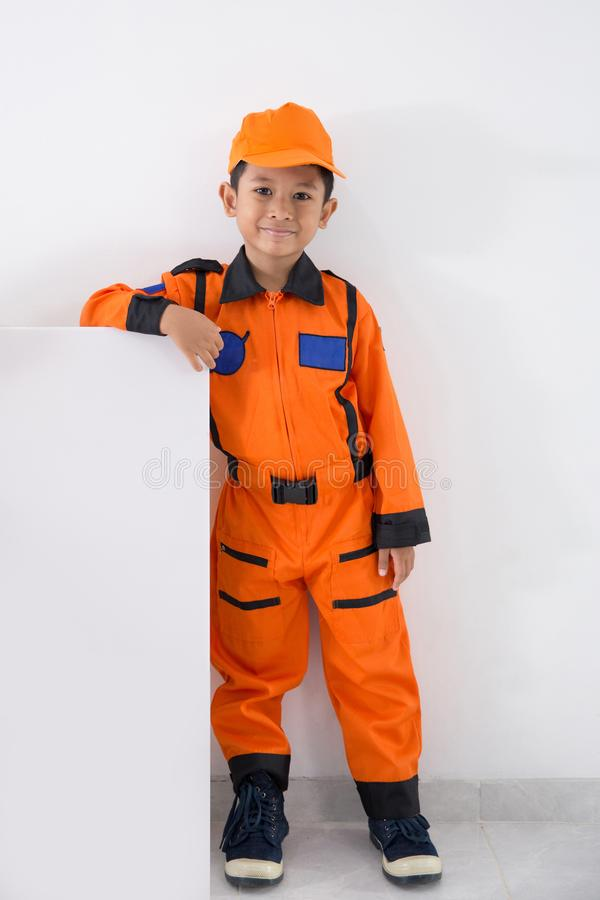 Asian little boy with technician, engineer or astronaut uniform stock images