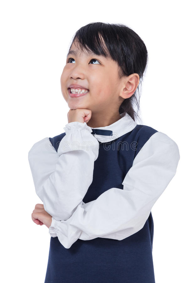 Portrait of Asian Little Girl thinking with hand on chin royalty free stock photo