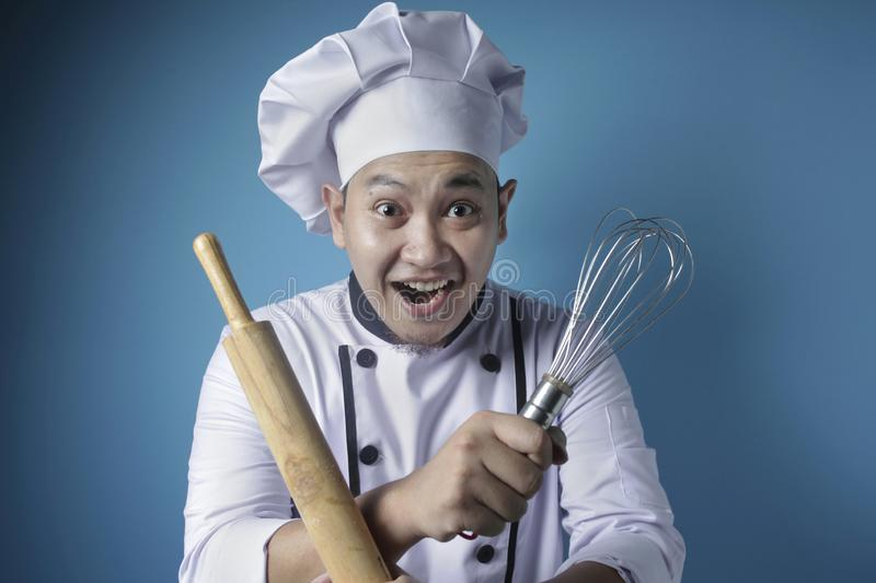 Asian Male Chef, Baker Holding Kitchen Tools, Ready to Cook stock photography